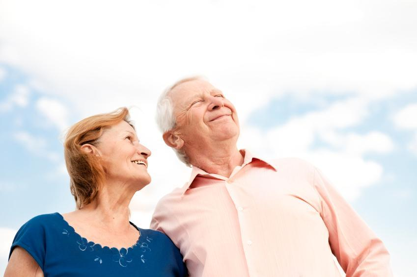 Older couple walking together gazing at the sky I Gum infection therapy at William T. McMaugh DDS
