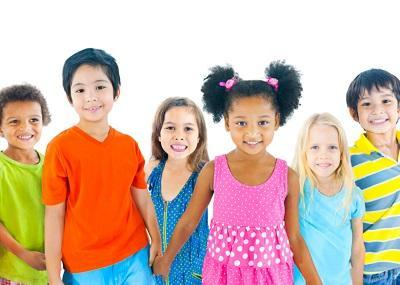 Multi-ethnic group of children holding hands smiling l Kid's dentist Harleysville PA